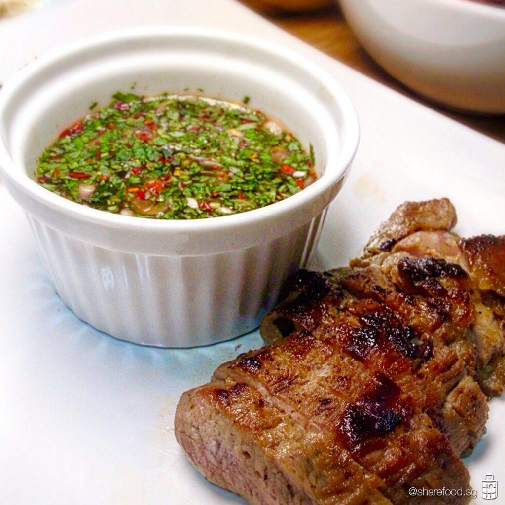 Thai grilled pork neck close up shot