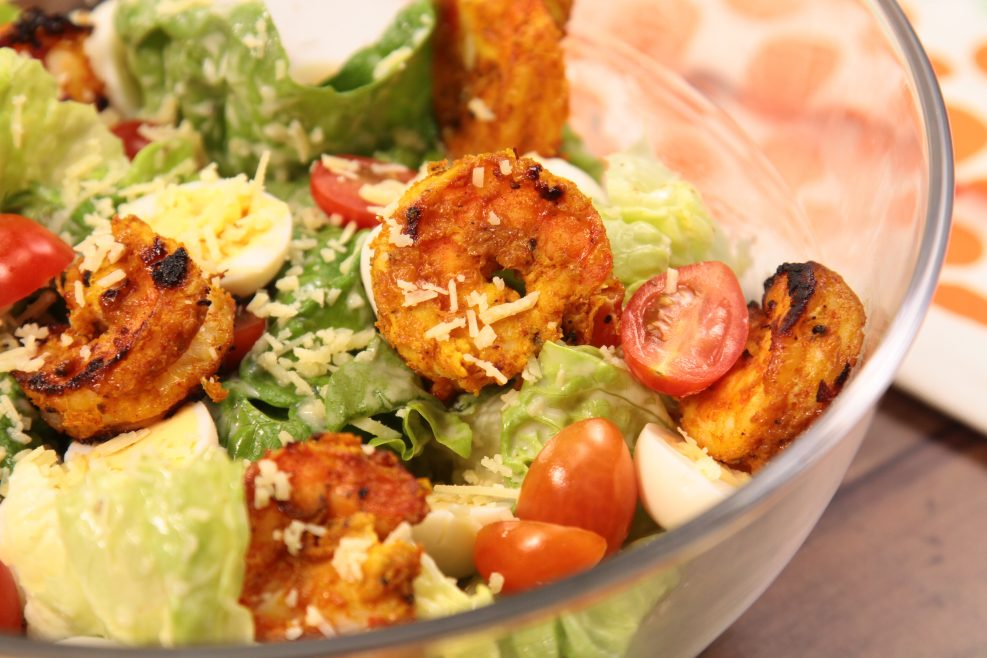 Caesar Salad with Smoked Tandoori Prawns close up shot