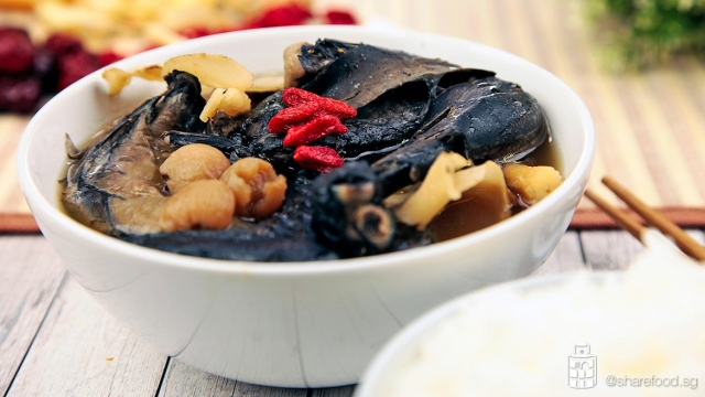 Nutritious black herbal chicken soup close up