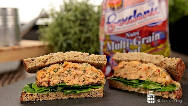 baked salmon cake sandwich with gardenia background