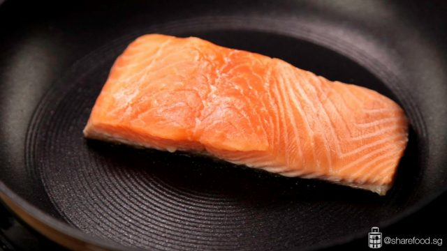 salmon cooking in a pan