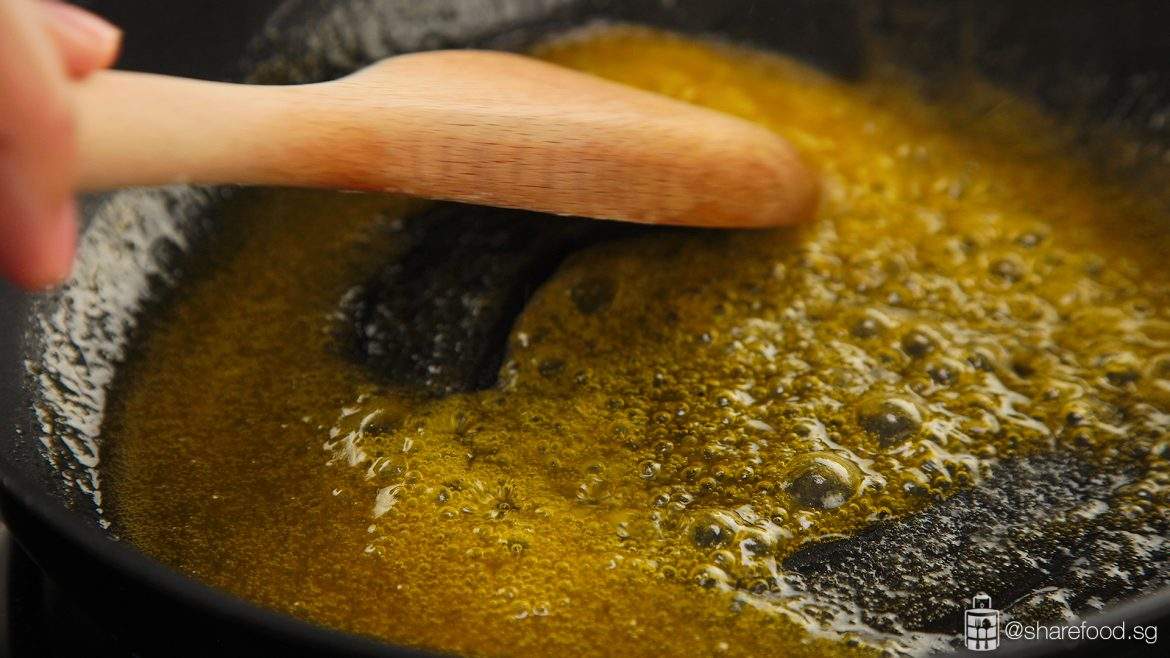 Spreading the olive oil on a pan