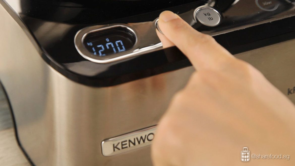 Kenwood's kFlex machine touching the button