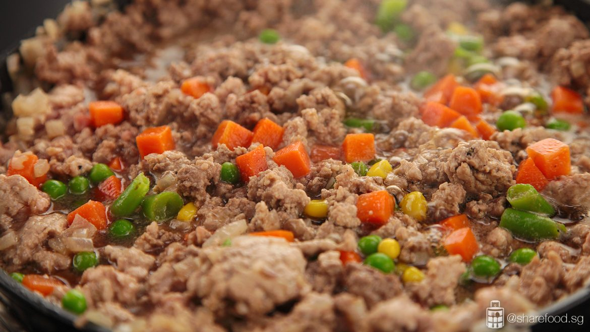 Cooking the minced beef with guinness stout beer