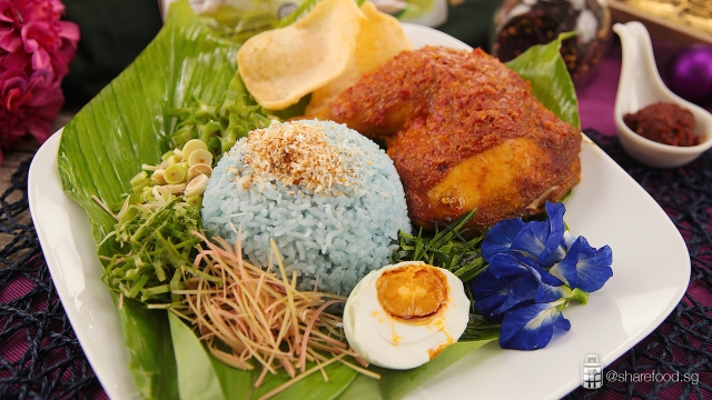 Nasi kerabu with ayam percik malaysian dish