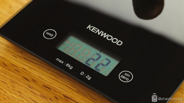 Dividing lotus paste with Kenwood weighing scale