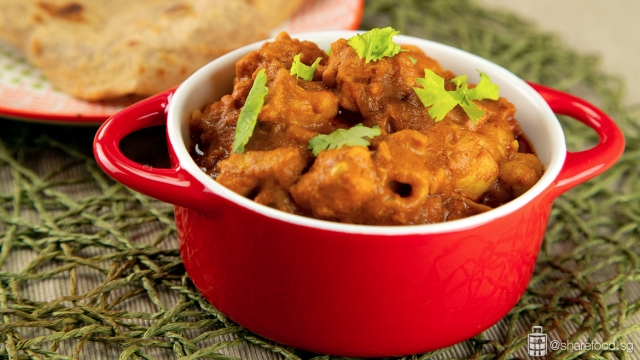 Ginger Masala Yoghurt Chicken Served with Naan