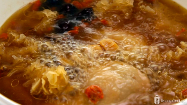 Snow Fungus Chicken Soup simmering over low heat