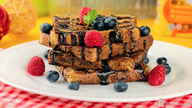 French Toast Waffle with Chocolate and Berries served on white dish plate