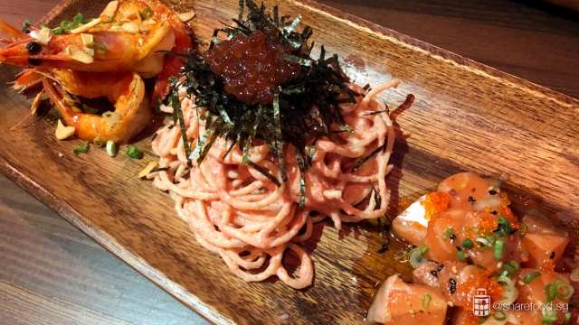 Mentaiko spaghetti served with original salmon poké, spicy shrimp and topped off with Hokkaido Ikura