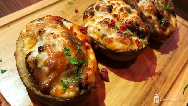 Baked potatoes stuffed with chicken, king oyster mushroom and covered with melted mozzarella cheese