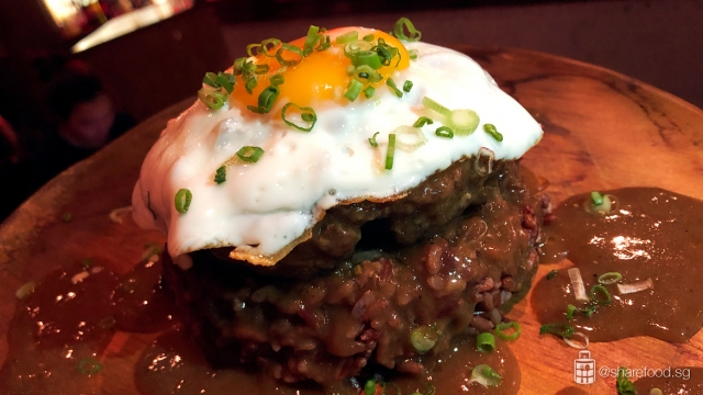 Delicious Wagyu beef patty topped with a red wine reduction sauce served with white or brown rice and topped off with an egg sunny side up