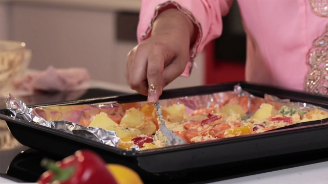 spread vegetables on baking tray lined with aluminium foil