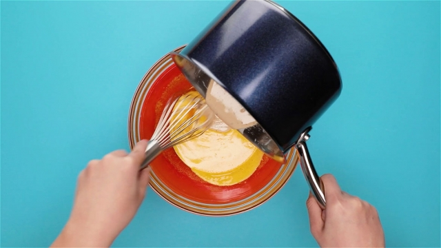Pour the custard mixture into the egg yolk mixture and whisk quickly