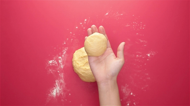 Tuck the sides of each small dough to shape them into nice, round balls