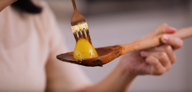 Poke a fork through the potato to check if it is cooked