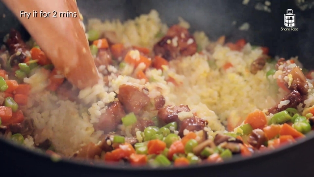 Frying pork and vegetables into Egg Fried Rice
