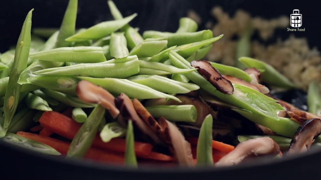 Stir fry vegetables in a pan
