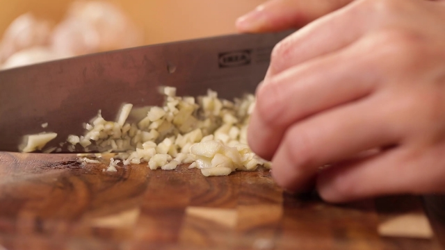 Mincing garlic with a knife