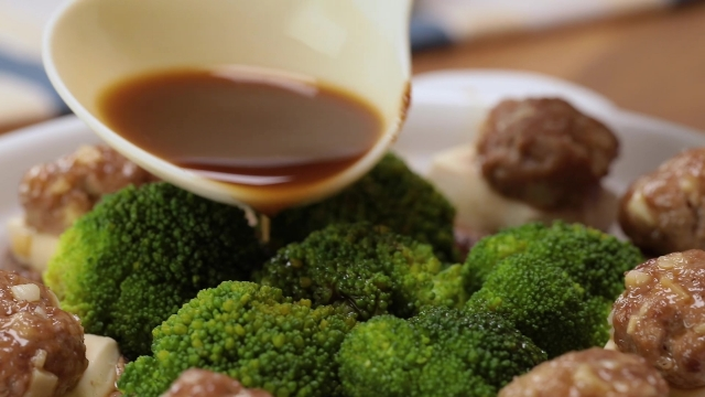 Spooing gravy over broccoli