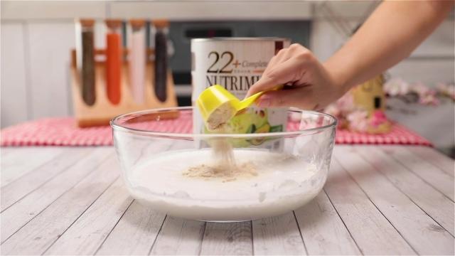 Adding Nutrimix Avocado powder to kueh lapis batter