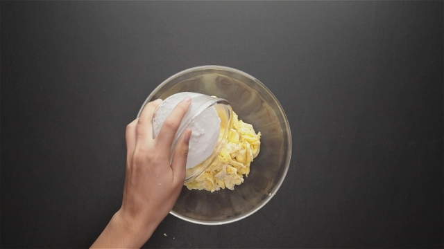 Adding thick coconut milk to durian pulp