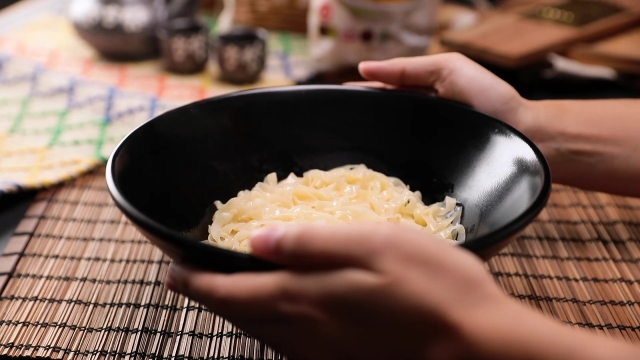 Cooked meepok noodles in bowl