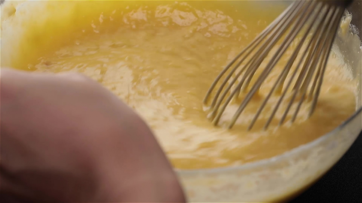 Whisking durian custard batter