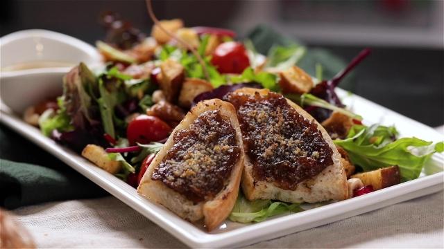 Zazz Salad with tomatoes, caramelised sweet onion bruschetta