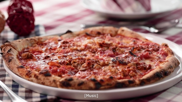 pizza with tomato sauce with ham, salami, sausage, cheese and ham