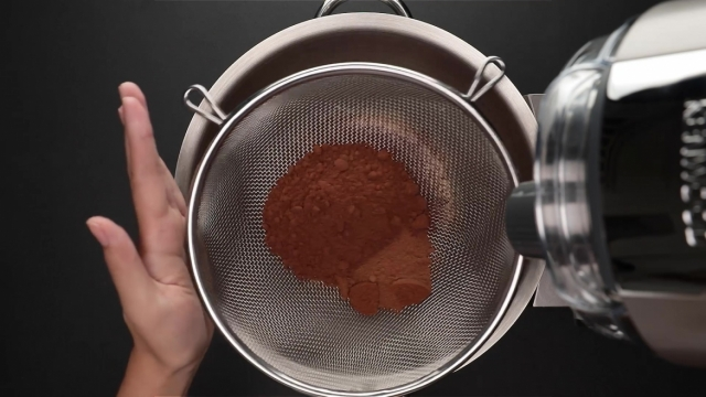 Sieving cocoa and milo powder into mixer