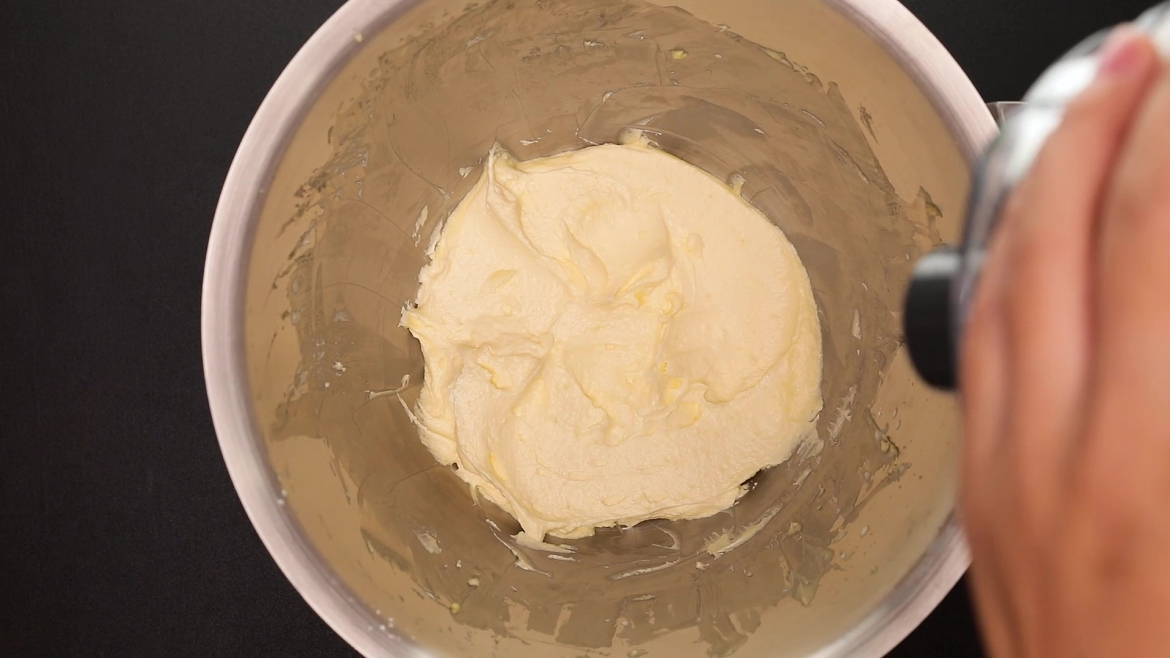 Whipped cake frosting in mixing bowl