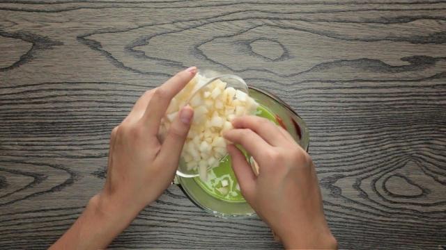 Adding chopped water chestnuts to green pandan batter