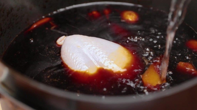 Adding water to braising sauce with whole chicken
