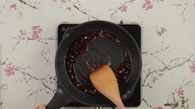 Cooked lap mei fan sauce in frying pan