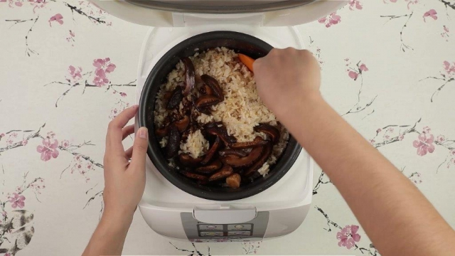 Mixing brown rice with mushrooms in rice cooker