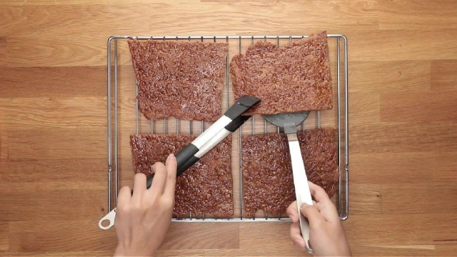 Placing baked bak kwa pieces onto wire rack