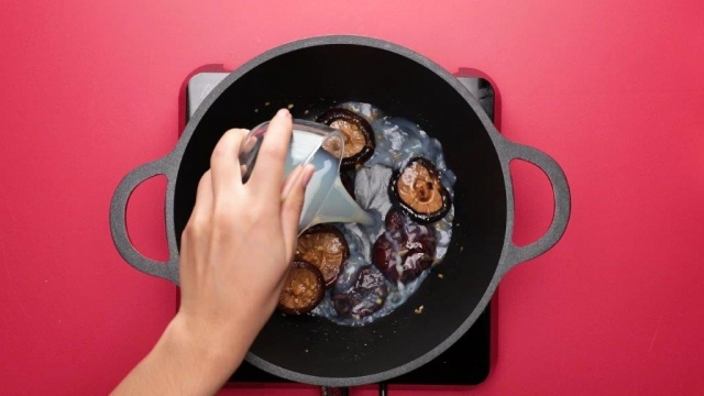 Stir frying mushrooms in a pot with a wooden spatula