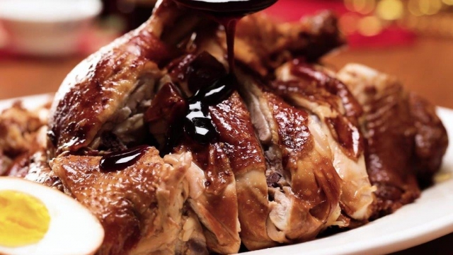 Pouring sauce over soy sauce chicken