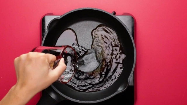 Pouring water into sauce in frying pan