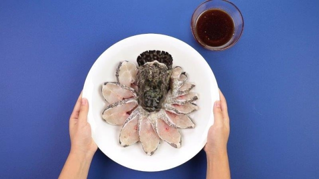 Raw sliced peacock grouper fish with sauce on the side