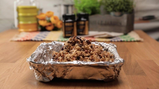 Granola mixture in lined aluminium baking tray