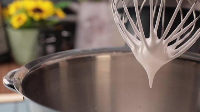 Whisking whipping cream until soft peaks