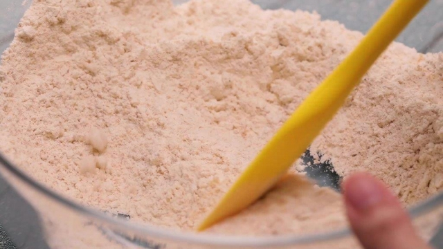 Flour in a bowl with spatula