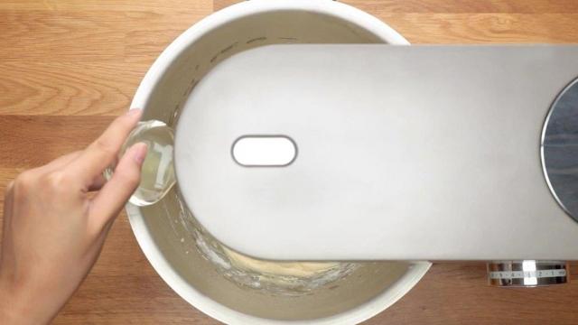 Pouring lemon juice into mixer