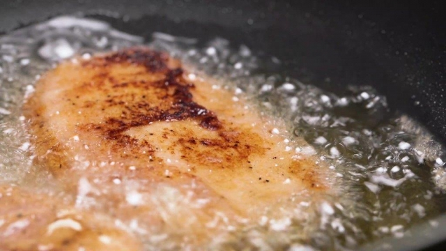 Shallow frying pork chops in frying pan
