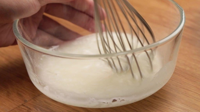 Whisking a lemon loaf cake glaze
