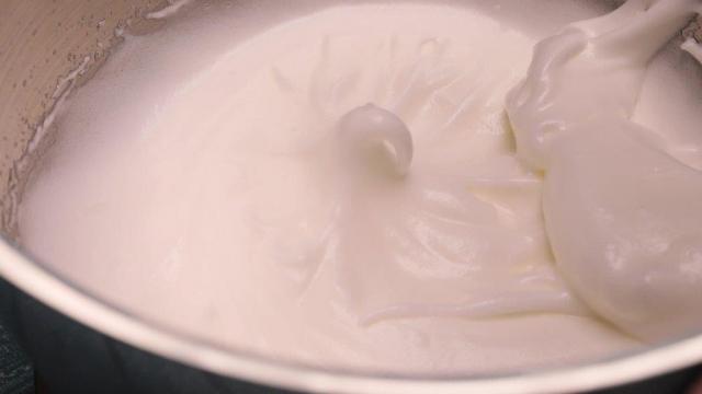 meringue beaten to stiff peak in mixing bowl