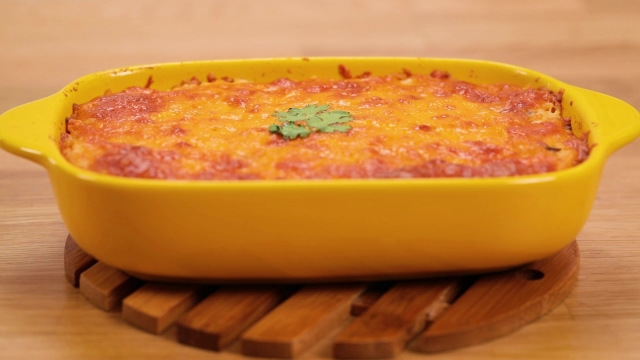 Spicy Saba fish baked rice in a yellow baking tin