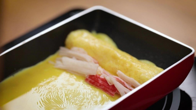 cooking crabmeat tamagoyaki in tamagoyaki pan